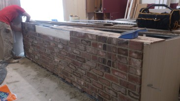 Steel-backed bricks